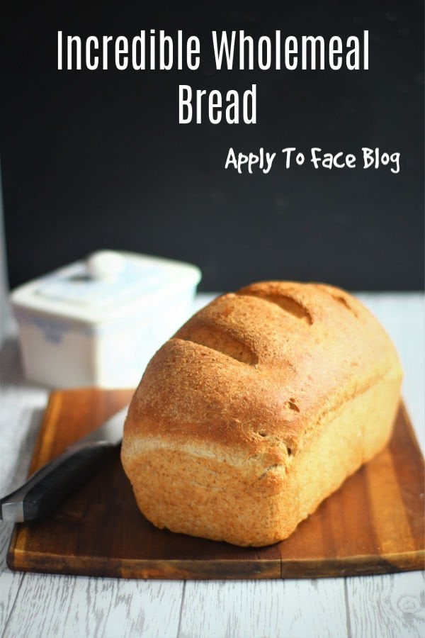 pin for wholemeal bread on a wooden board with a knife