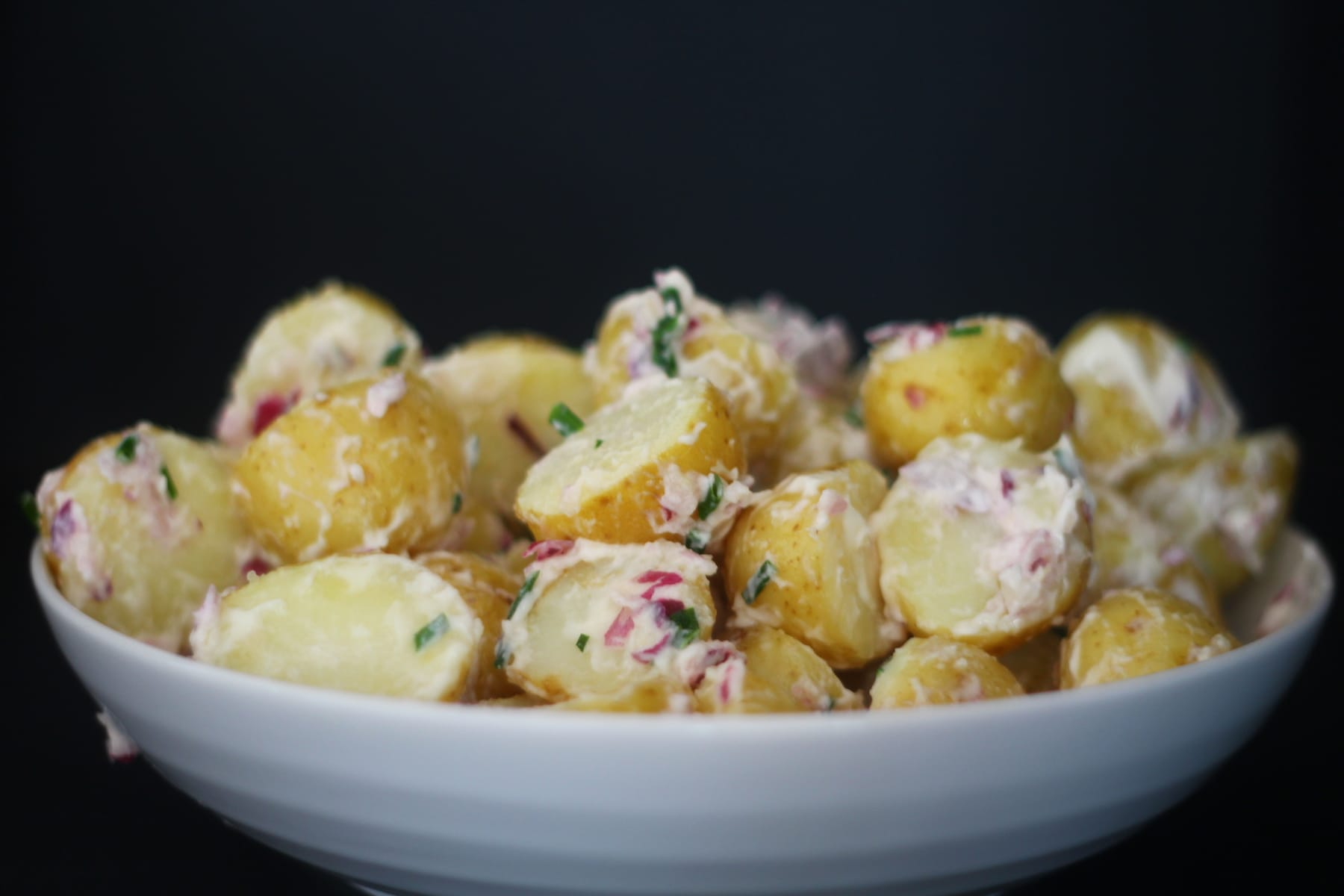 Potato Salad with a Mayo Dresssing, Red Onion and Chives.