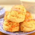 stack of cheese scones on a plate.