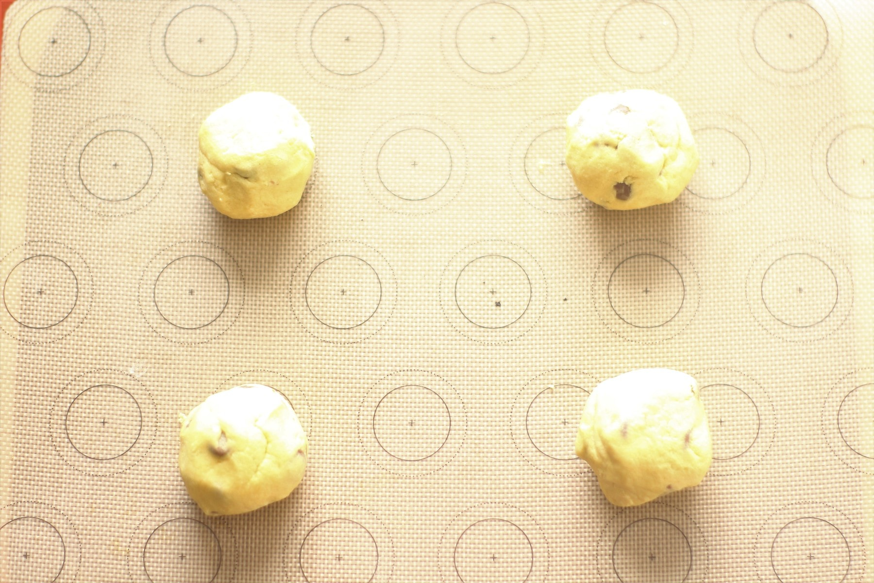 Cookie Dough Balls on a lined baking tray