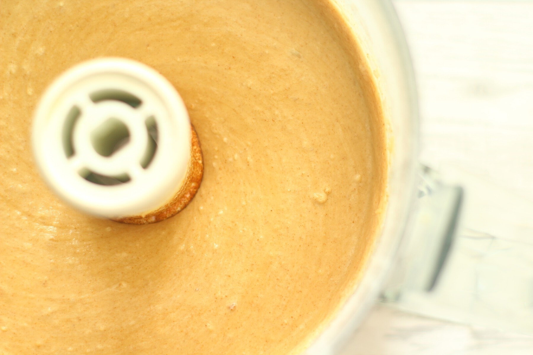 Coffee and walnut cake batter in a food processor