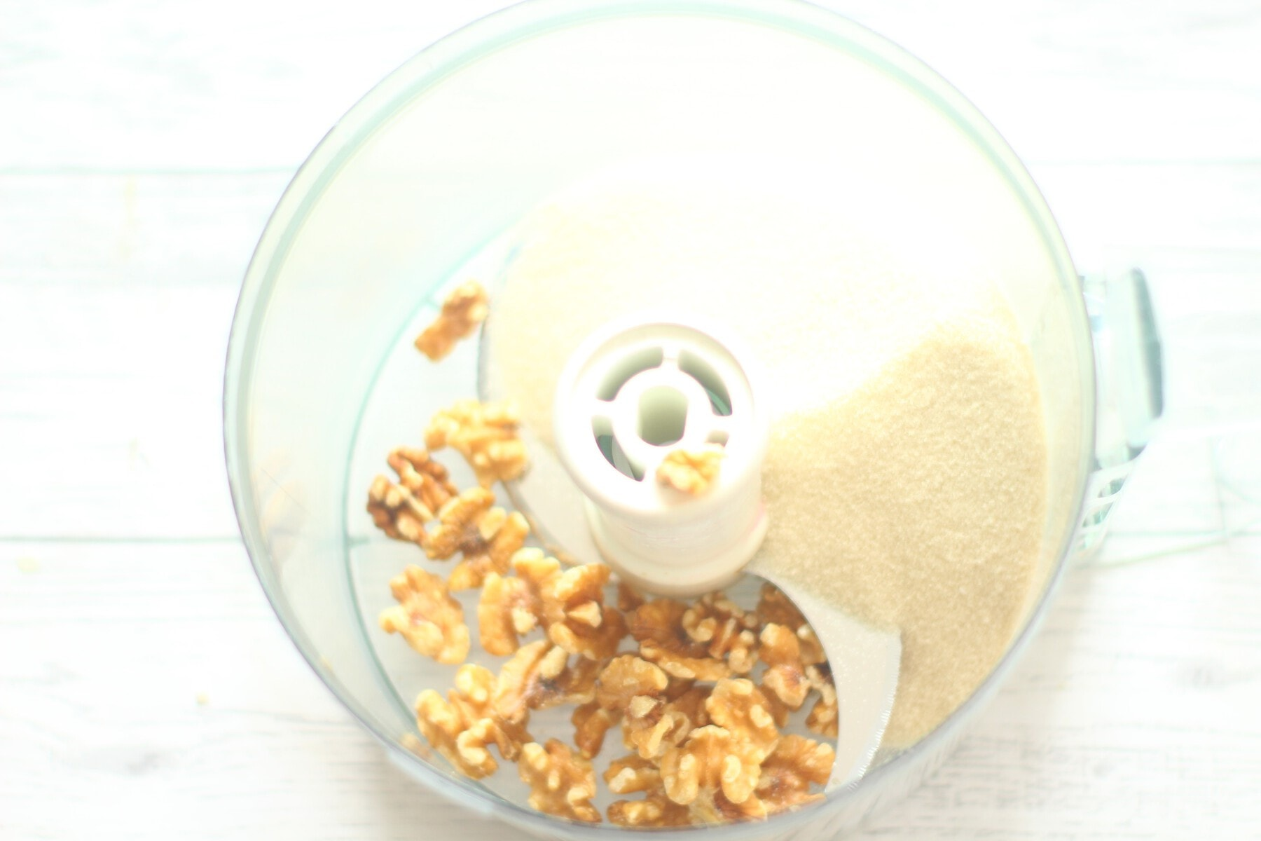 walnuts and sugar in a food processor