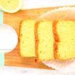 sliced lemon drizzle cake on a board