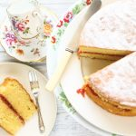 vicoria sponge cake with a slice of cake on a plate with a cake fork