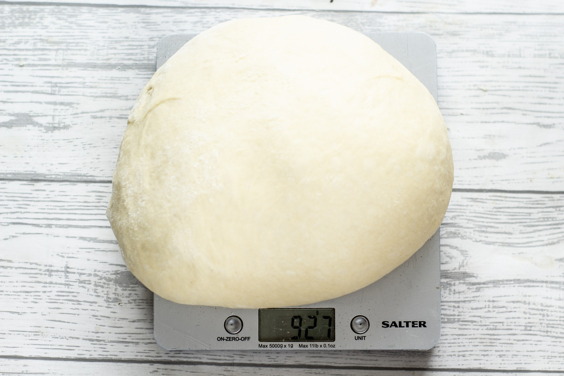 best bread rolls dough being weighed on digital scales