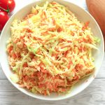 piled high coleslaw in a serving bowl