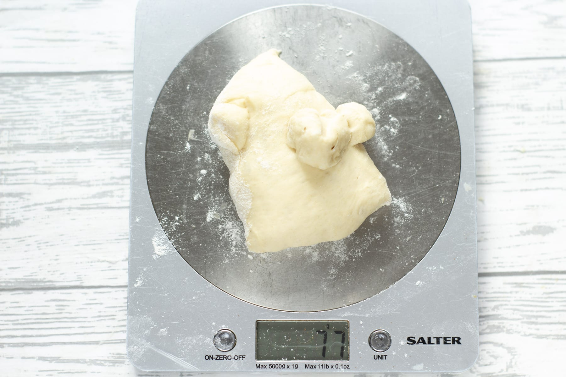 weighing dough on digital scales