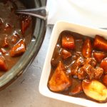 slow cooker beef casserole in a bowl with vegetables