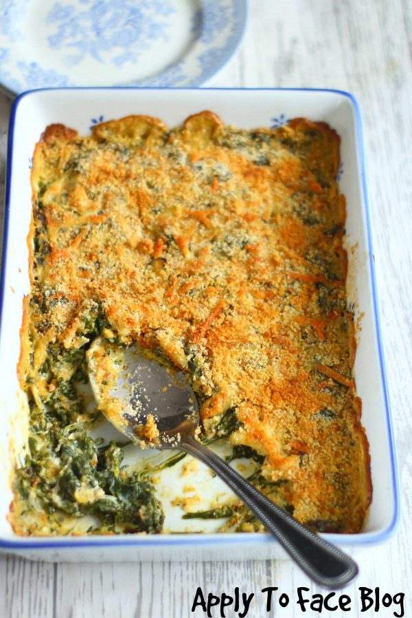 creamed spinach in a dish with a serving spoon.