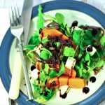roast butternut squash salad and feta cheese on a plate