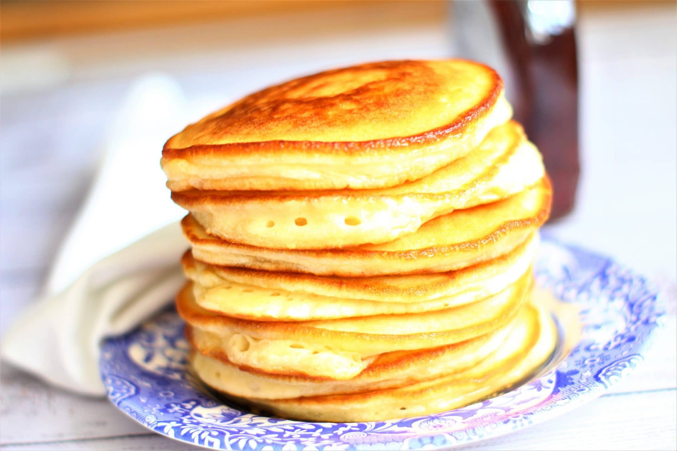 stacked pancakes on a blue and white plate