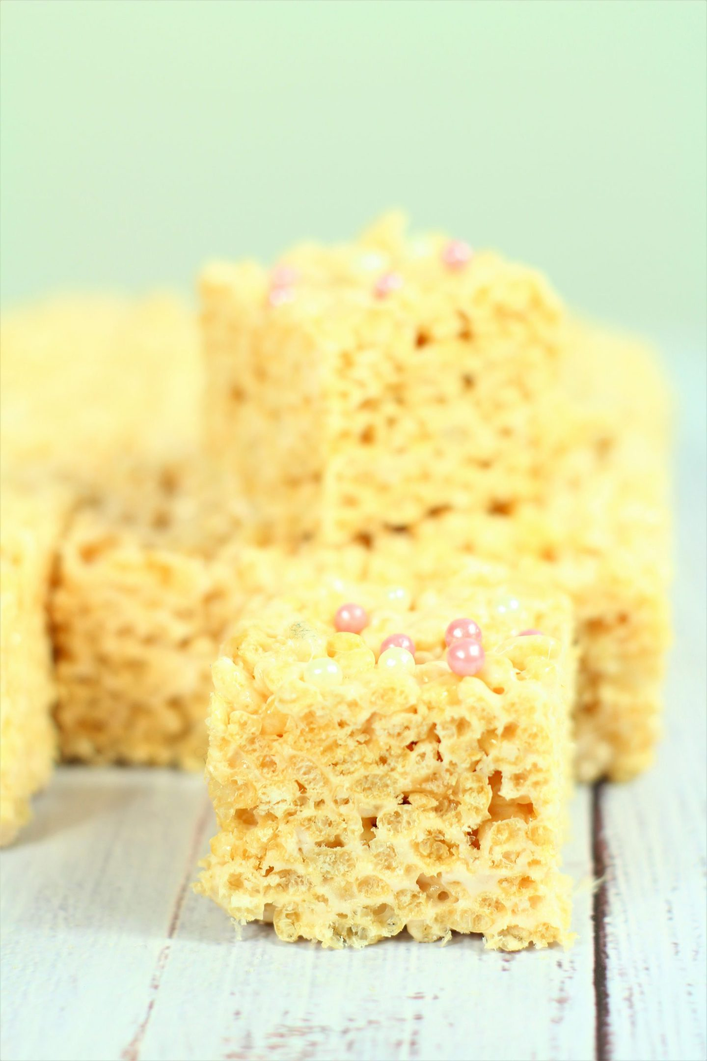 marshmallow krispies stacked up with sprinkles on top.